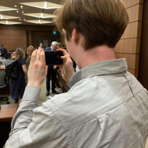 Christian Paas-Lang, intern with The Canadian Press' Ottawa bureau, takes a picture of the parliamentary ethics committee, just before it sits to discuss the SNC-Lavalin affair.