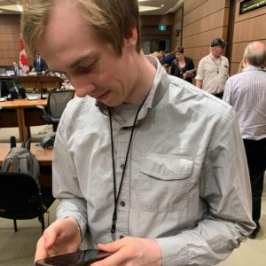 Christian Paas-Lang, intern with The Canadian Press' Ottawa bureau, checks back with his editors after a parliamentary ethics committees adjourns a meeting on the SNC-Lavalin affair.
